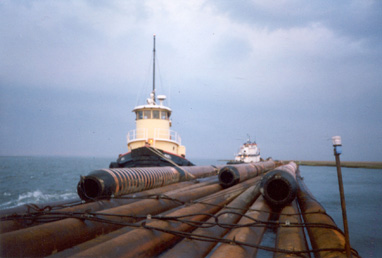 Marie-J while under Coastline Marine Flag with Dredge Pipe Raft, Atlantic City, NJ